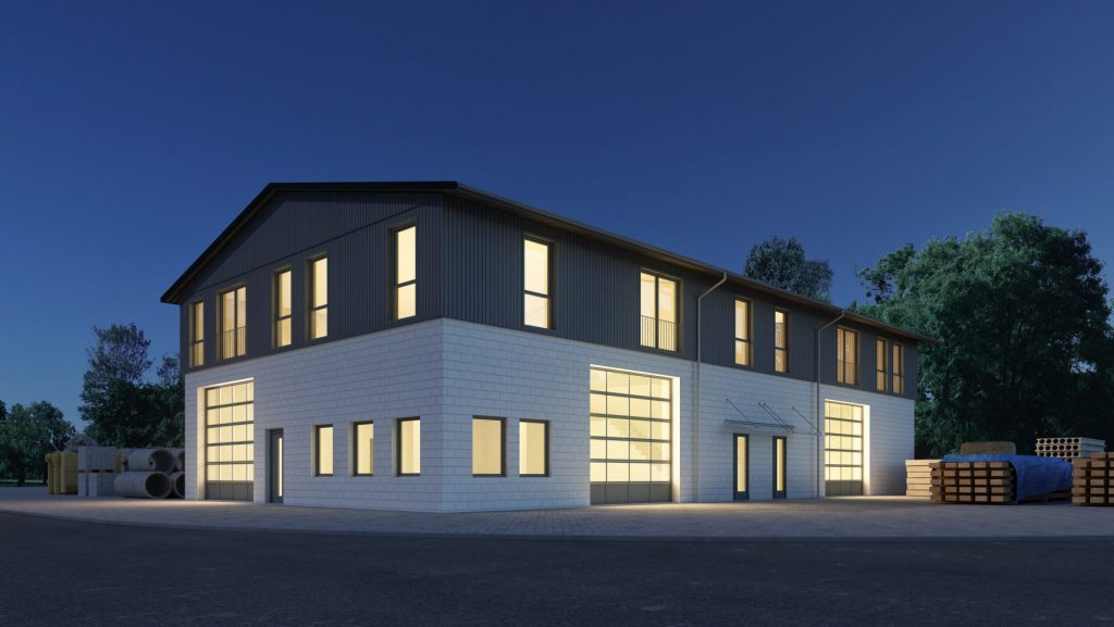 Außenansicht einer beleuchteten Betriebshalle oder Lagerhalle in der einsetzenden Dunkelheit.
